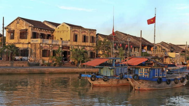 Historic buildings hug the river at Hoi An in central Vietnam
